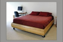 Bed with Curving Bamboo Frame
